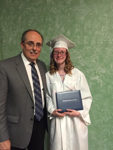 Pastor Rusty Yost with our Valedictorian, Cierra Michel.